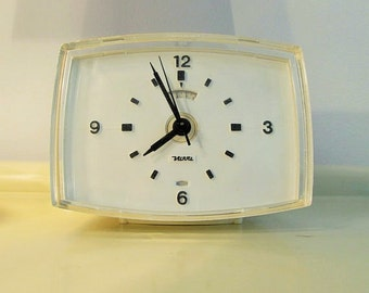 Vintage softly...Glow in the Dark Electric  Alarm Clock in cream color made by Nova in France in the 70s