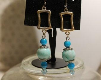 Light blue swirl drop earrings