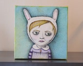 Rabbitgirl - small canvas painting of girl wearing rabbit hat and a carrot necklace