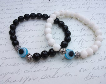 Evil eye protection white coral or black glass bead bracelet