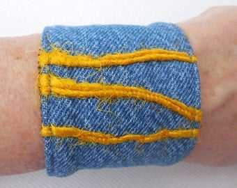 Fabric Bracelet in denim with yellow wool yarn, recycled jeans cuff, upcycled earth friendly, vintage jean jewelry, for 6 to 6/12 inch wrist
