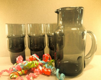 Mid Century Modern Smoke Gray Glass Drink Set with Pitcher and Four Glasses..