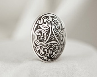 Celtic Art Spiral Pendant, Etched in Sterling Silver from The Book of Kells, made in Ireland.