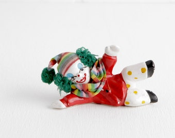 Vintage Creepy Clown Doll with Jester's Hat and Scarf in Weird Reclining Position