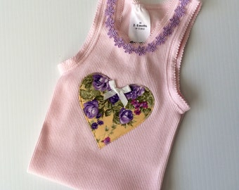 Pretty baby top, baby singlet , tank top, size 3-6 months. Cute daisy trim.
