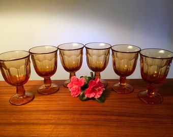 Set of six small amber glass goblets