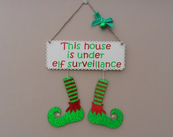 This house is under elf surveillance, hanging elf boot plaque. Christmas decoration. Elf antic.