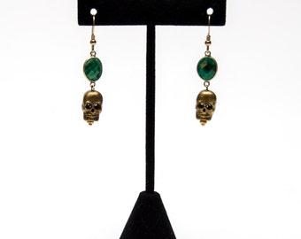 Emerald skull earrings
