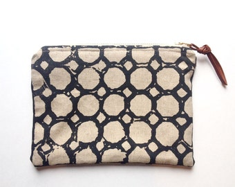 pouch with brass zipper in charcoal circles pattern