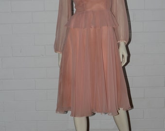 Dreamy dusty pink 1950s-style chiffon dress with frills and sheer long sleeves
