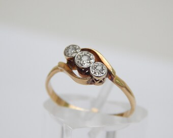 art deco ring - 3 stone diamond bypass ring in 18ct gold and platinum