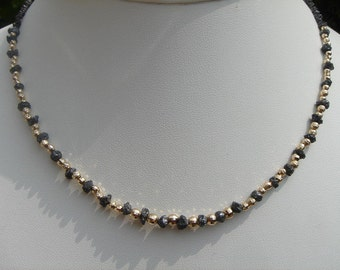 Necklace in gold 585 (14 K) with black diamond! Very precious!