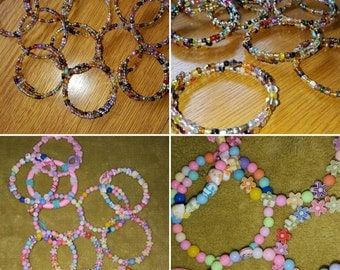 Girls party favours.memory wire and sead bead bracelets for older girls at a princess party. See other post for little girls bracelets.
