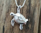Sterling silver sea turtle with mother of pearl inlay on a sterling silver 18 inch solid 2mm rope chain.