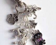 Raining cats and dogs bag charm/ keyring