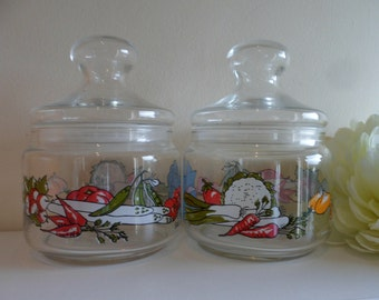 Pair of Retro french glass storage jars with colourful decals of vegetables and kitchen untensils