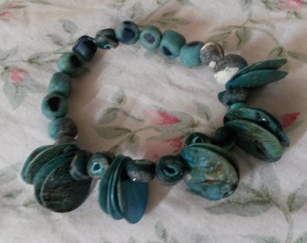 Hand crafted beaded bracelet with blue tile beads