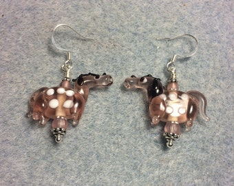Translucent pink with white spots lampwork horse bead earrings adorned with pink Czech glass beads.