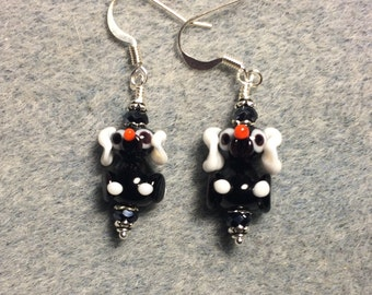 Small black and white puppy dog lampwork bead earrings adorned with black Chinese crystal beads.