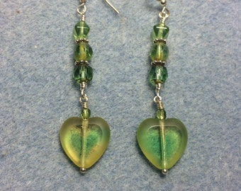 Yellow green Czech glass heart bead dangle earrings adorned with yellow green Czech glass beads.