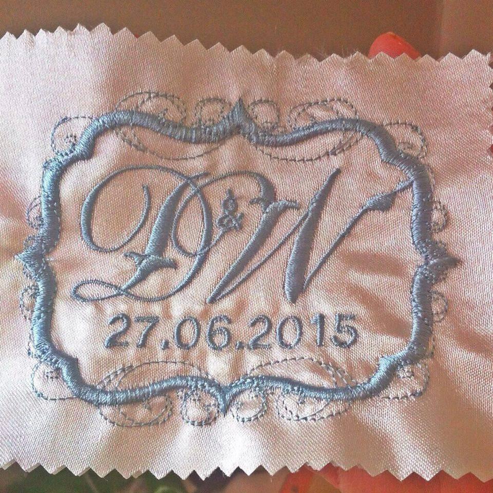 Embroidered label for wedding dress swirl design border