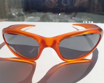 oakley sunglasses 7.99  oakley scar sunglasses silver lens orange frame rare