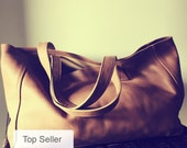 Caramel leather tote, super soft leather. Traditional,shoulder leather tote, long strong straps,perfect tote bag. Large shoulder bag, lined.