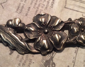 Antiqued brass floral flourish 1 pc