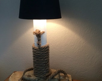 Driftwood lamp.  Driftwood post and rope on driftwood base   40 cms
