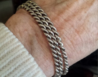 Three sterling silver vintage twisted bangles