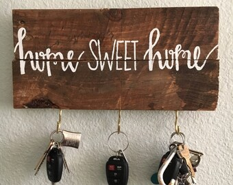 Home Sweet Home sign with key hooks