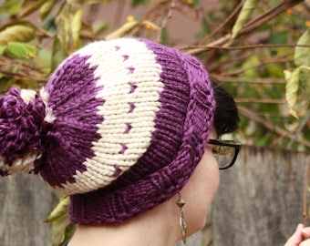 Cozy purple and cream knitted hipster hat with a striped pom-pom