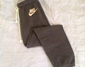 Reworked Nike Just Do It Loungewear Joggers in Dark Grey