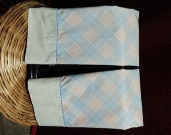 2 pc 1960's blue and rusty plaid vintage pillow cases , like new.