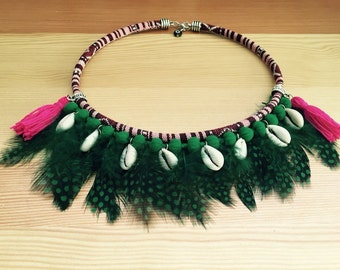 Ethnic necklace with green feathers.