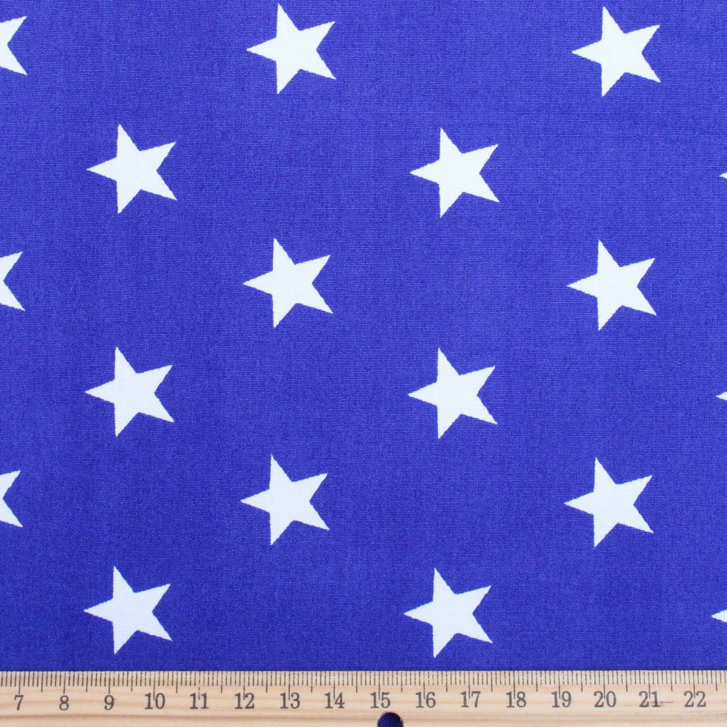 White stars on royal blue cotton poplin fabric star for Star fabric australia