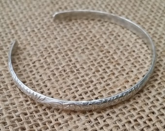 Sterling silver, Bangle, 4mm wide  diameter 5.5 cm x 5 cm.