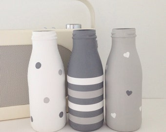 Set of three hand painted mini milk bottles