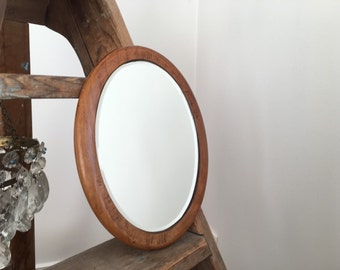Former bevelled wood oval mirror.