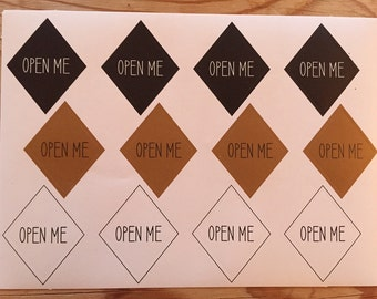 "12 ""OPEN ME"" stickers"