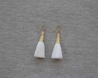 White Tassel Earrings with Gold Trim