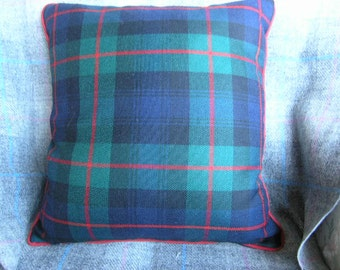 Pure wool tartan cushion cover with red piping.