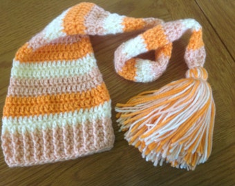 Long tailed baby hat in orange, peach and cream