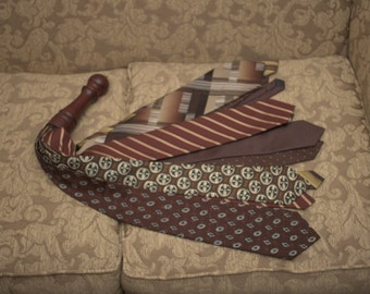 Upcycling kink, silk tie flogger, BDSM recycling, brown and gold whip