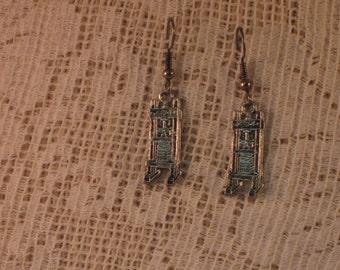 Antiqued silver earrings of 19th century standing book press