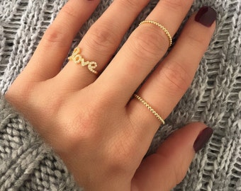 Love ring. Solid silver love ring set. Set of one gold love ring and two bead rings . Rose gold love ring. Cursive love ring. Silver rings.