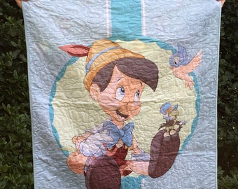 Pinocchio Baby or Child Quilt in Soft Blues