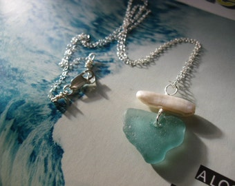 Beautiful Aqua sea glass with fresh water pearl on 18 inch sterling silver chain.
