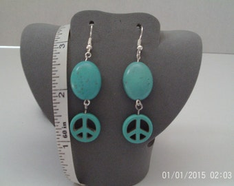 Magnesite dyed peace sign dangle turquoise earrings
