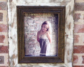 Heavily distressed 11x14 picture frame in white.